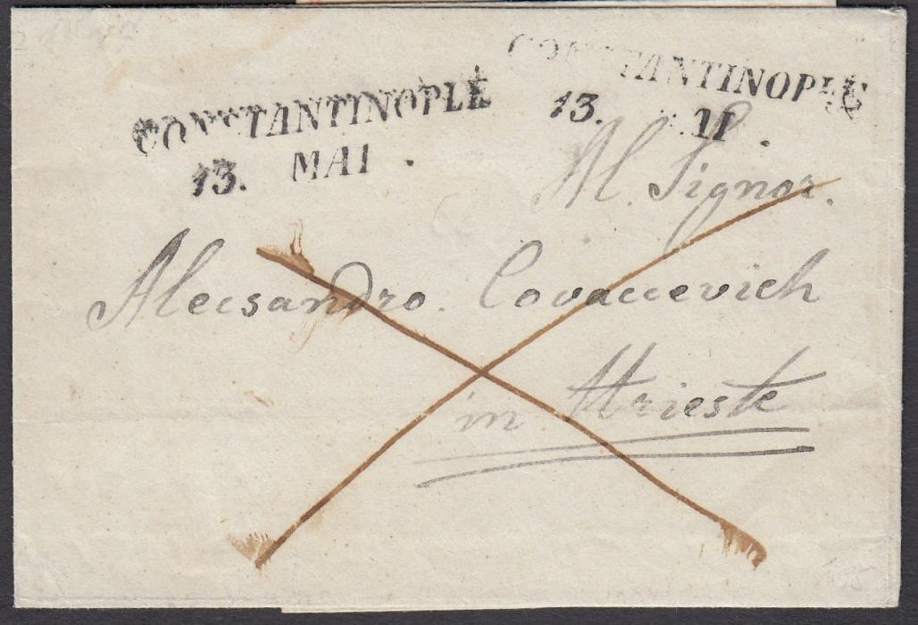 AUSTRIAN LEVANT 1847 wrapper to Trieste bearing two-line dated Constantinople handstamp. St. Andrews cross indicating payment to destination.