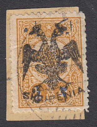 ALBANIA 1913 Double Headed Eagle overprints, 2pa on 5pa ochre, on piece, neatly cancelled, signed and cert. Holcombe. A scarce stamp!