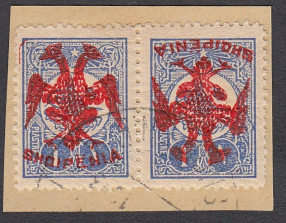 ALBANIA 1913 Double Headed Eagle Overprints, 1pi ultramarine, horizontal pair with red overprint, on right stamp inverted, on piece neatly cancelled, signed Holcombe. (Scott 7 var).