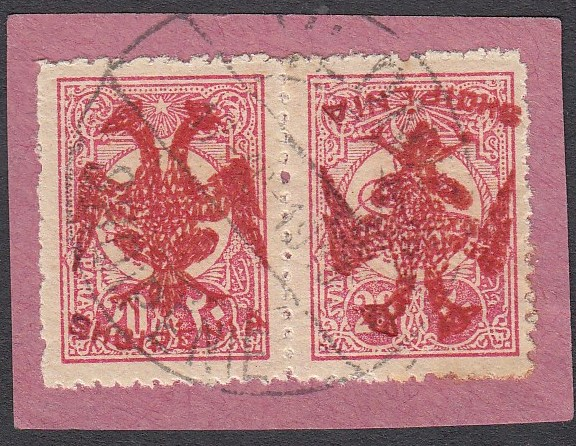 ALBANIA 1913 Double Headed Eagle Overprints, 20pa rose with red overprint, horizontal pair on piece, right stamp with inverted overprint, signed and cert. Raybaudi. Very rare and attractive ! (Scott 6 var.)