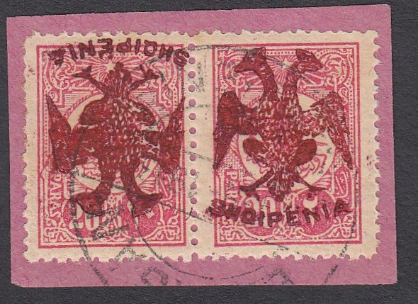 ALBANIA 1913 Double Headed Eagle Overprints, 20pa rose with red overprint, horizontal pair on piece, left stamp with inverted overprint, signed and cert. Raybaudi. Very rare and attractive! (Scott 6 var.)