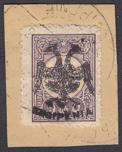 ALBANIA 1913 Double Headed Eagle Overprints, 5 pi lilac on piece neatly cancelled, signed and cert. Scheller. A scarce stamp, only 650 pieces have been issued. (Scott 10).