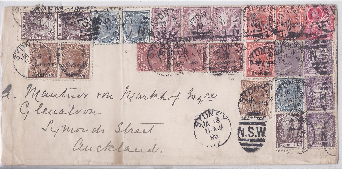 Australia (New South Wales) 1896 (JA 13) long multi franked cover to Auckland, New Zealand, the franking including surcharges with 9d. on 10d. vertical strip of three and 1891 7½d. on 6d. and 12½d. on 1s. pairs and a single, 1893 10d., 188-89 8d Lyrebird horizontal strip of three. Vertical filing crease, arrival backstamp. A striking cover.