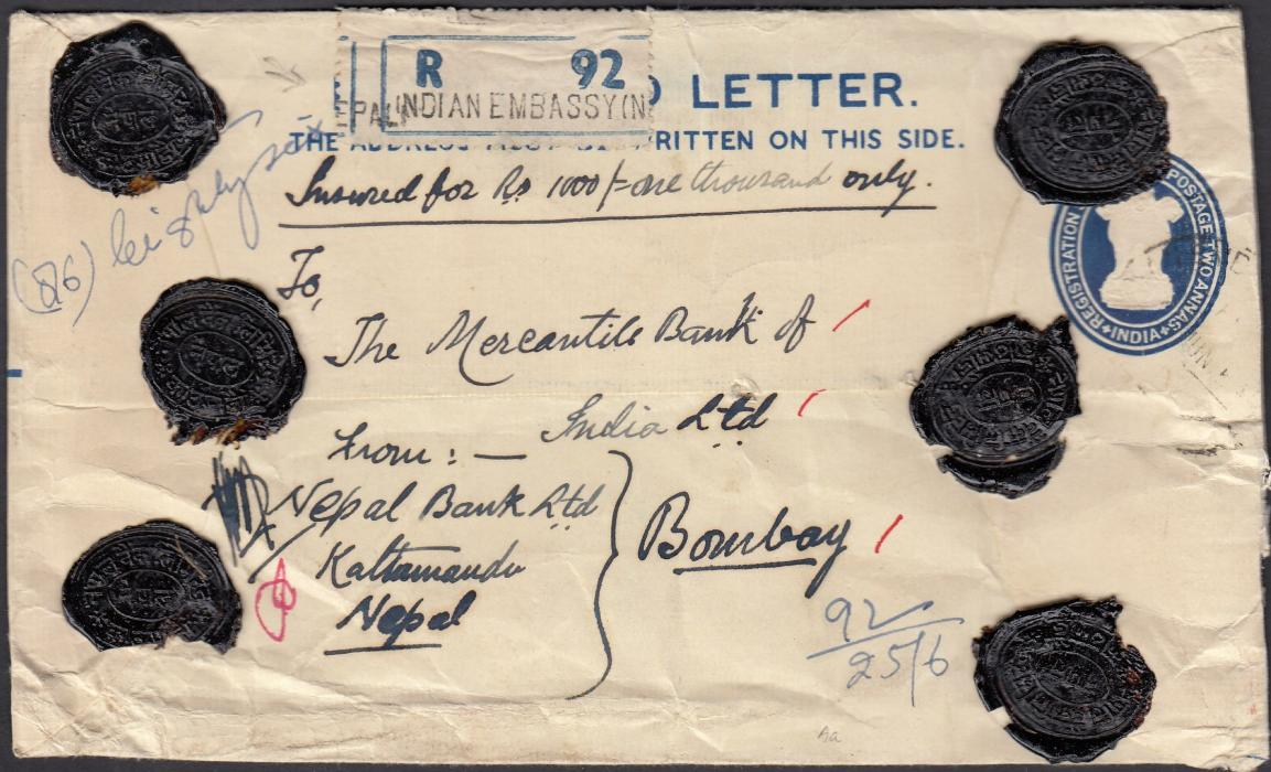 "INDIA (Post Offices in Nepal) 1954 registered postal stationery envelope to Bombay additionally franked on reverse with 1a., 2a., 8a. and 2 x 1r. tied ""INDIAN EMBASSY NEPAL"" cds, handstamped registration label on front together with six wax seals."