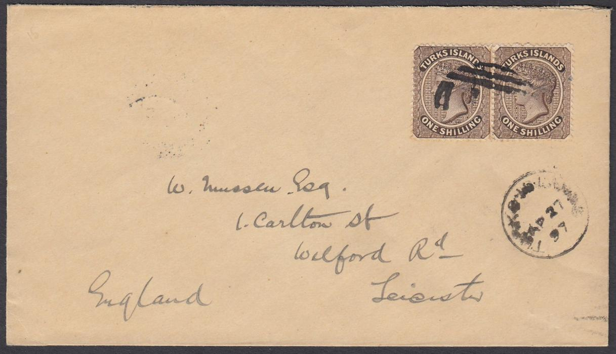 TURKS ISLANDS 1897 cover to Leicester, England, bearing pair 1s cancelled unclear T1 obliterator with Turks Islands cds in association, arrival backstamp; fine clean condition.
