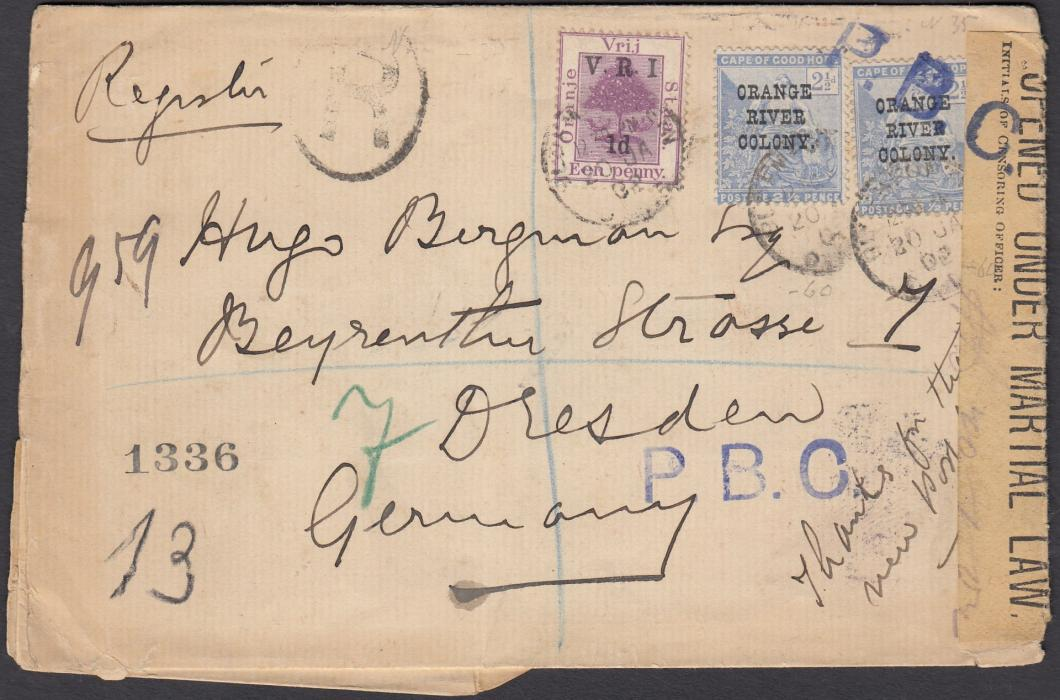 "SOUTH AFRICA (Orange River Colony) 1902 registered cover to Dresden, Germany, franked OFS 1d overprinted V.R.I. 1d and two CGH 2�d overprinted ""Orange River Colony"" tied by BLOEMFONTEIN date stamp, blue violet P.B.C. handstamps, one overstriking stamp and tape Opened Under Martial Law label, arrival backstamp."