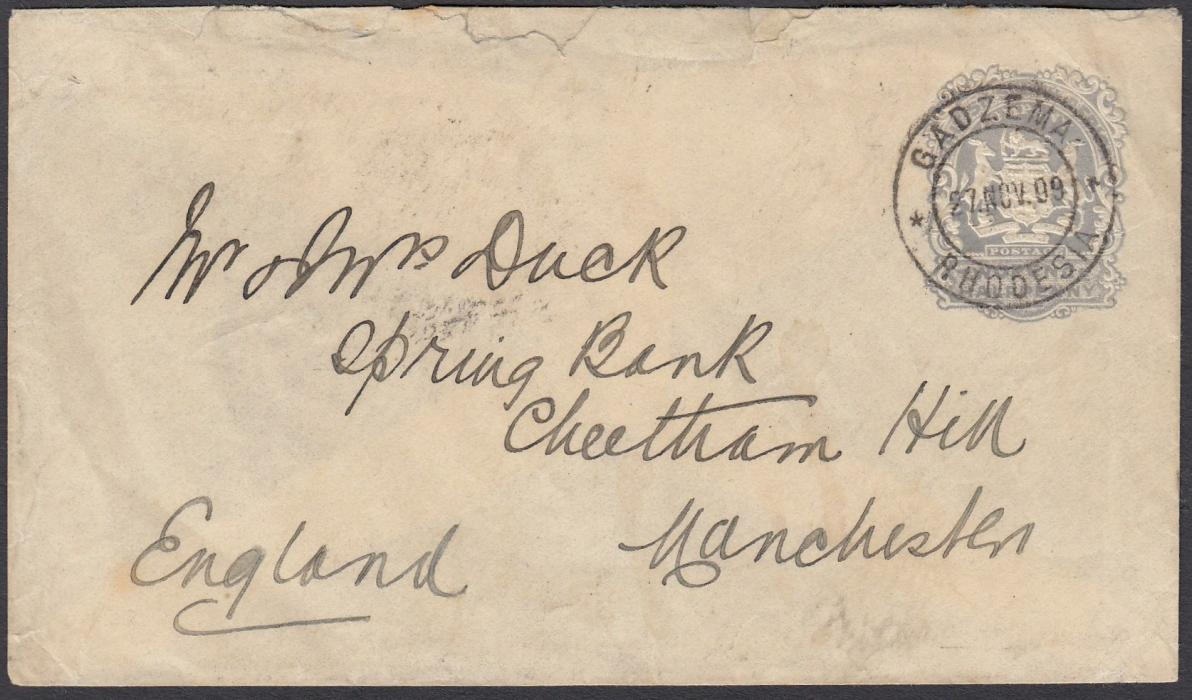 RHODESIA 1909 2�d postal stationery envelope to Manchester cancelled GADZEMA cds, arrival backstamp; a little roughly opened at top otherwise fine with a clear cancel.