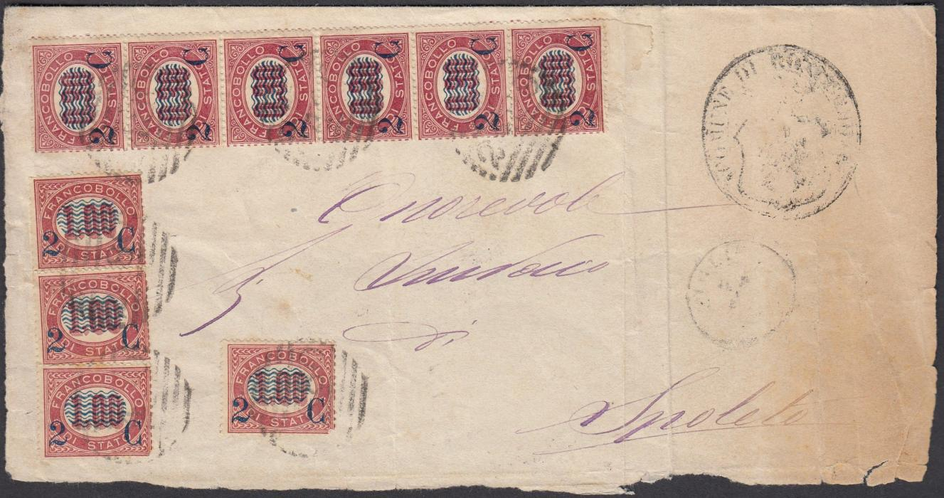 ITALY 1881 part wrapper to SPOLETO franked 2c. on 0,30 vertical strip of six and 2c. on 1,00 (4) tied unclear numeral obliterators; a fine strip of six, rare on cover.