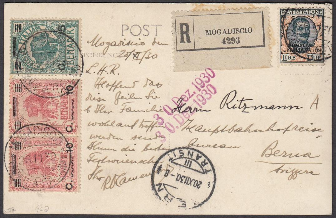 ITALIAN COLONIES: (Somalia) 1930 (26.11.) registered picture postcard (of elephant at night) to Switzerland franked 5c. on 2b., pair 10c. on 1a. and a 2L. tied MOGADISCIO cds, registration label at top, arrival cds at base. Fine condition.