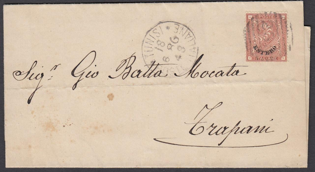 ITALY: (Tunisia) 1881 wrapper to TRAPANI franked with Estero overprinted 2c. tied 235 numeral with TUNISI/POSTE ITALIANE cds in association to left, arrival backstamp. Fine printed matter rate item.