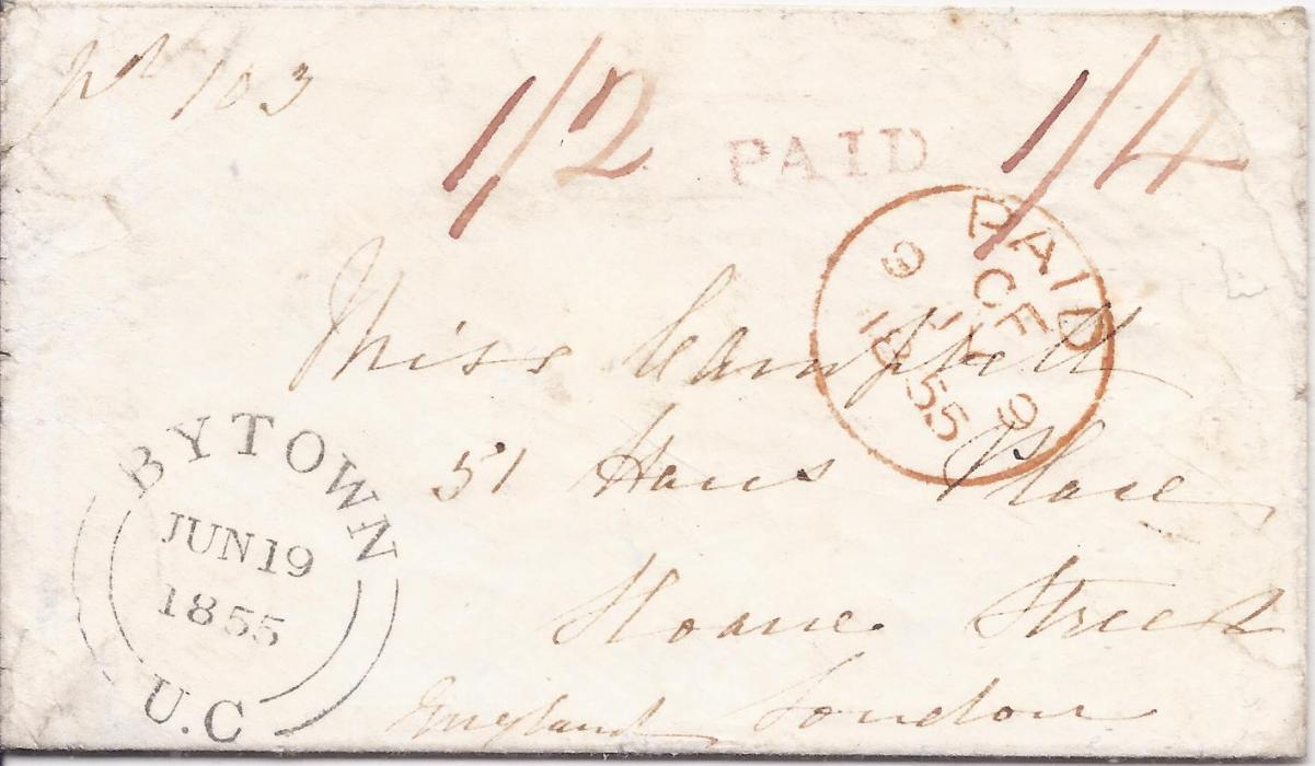 "Canada 1855 cover to London bearing fine Bytown U.C. date stamp, red manuscript ""1/2"" (sterling) and ""1/4"" (currency) with hanstaruck PAID in between, reverse with Montreal transit cds, arrival on front."