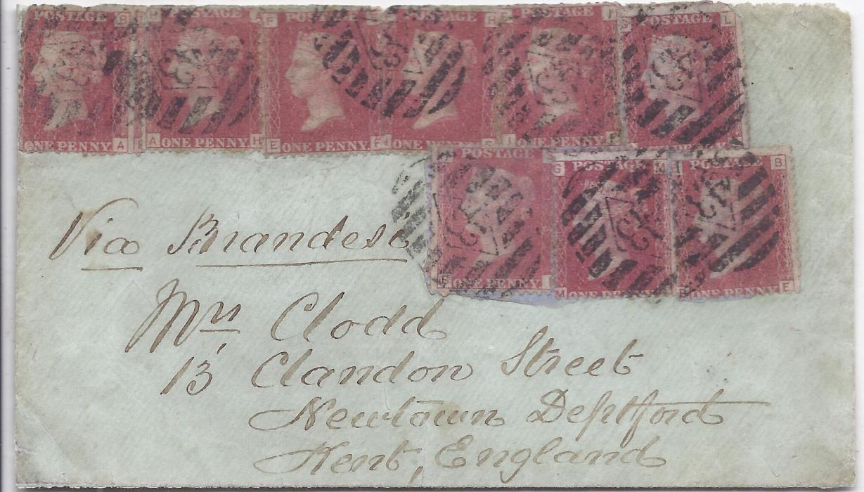 "Ceylon 1877 Ship's mail bag cover (flap missing) to Kent bearing Great Britain 1d red plates 178, 179 (5) and 182 (3), some apparently re-used with previous fragments beneath. This 9d, was equivalent of 36c. rate, cancelled by '43' numeral obliterators, endorsed ""Via Brandesi"" but carried via Southampton rather than Brindisi with Feb 26 1877 transit backstamp. Ex Scott-Archer."