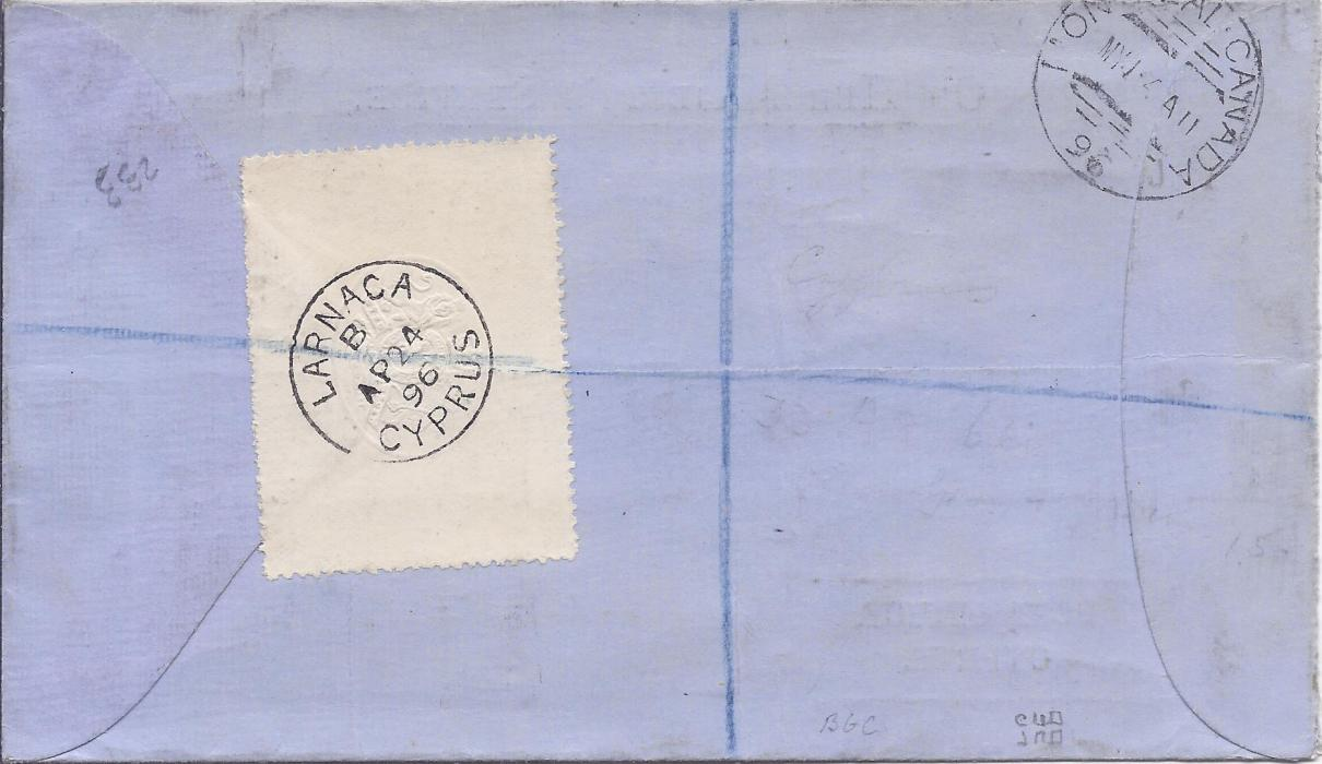 Cyprus 1896 (AP 24) �On Her Majesty�s Service� blue Post Office envelope registered to Montreal, Canada, bearing single franking 6pi. sepia and green tied Larnaca square-circle, red registration at left and London transit top centre. Reverse with white perforated sealing label cancelled by fine Larnaca cds, arrival backstamp. Very fine condition.