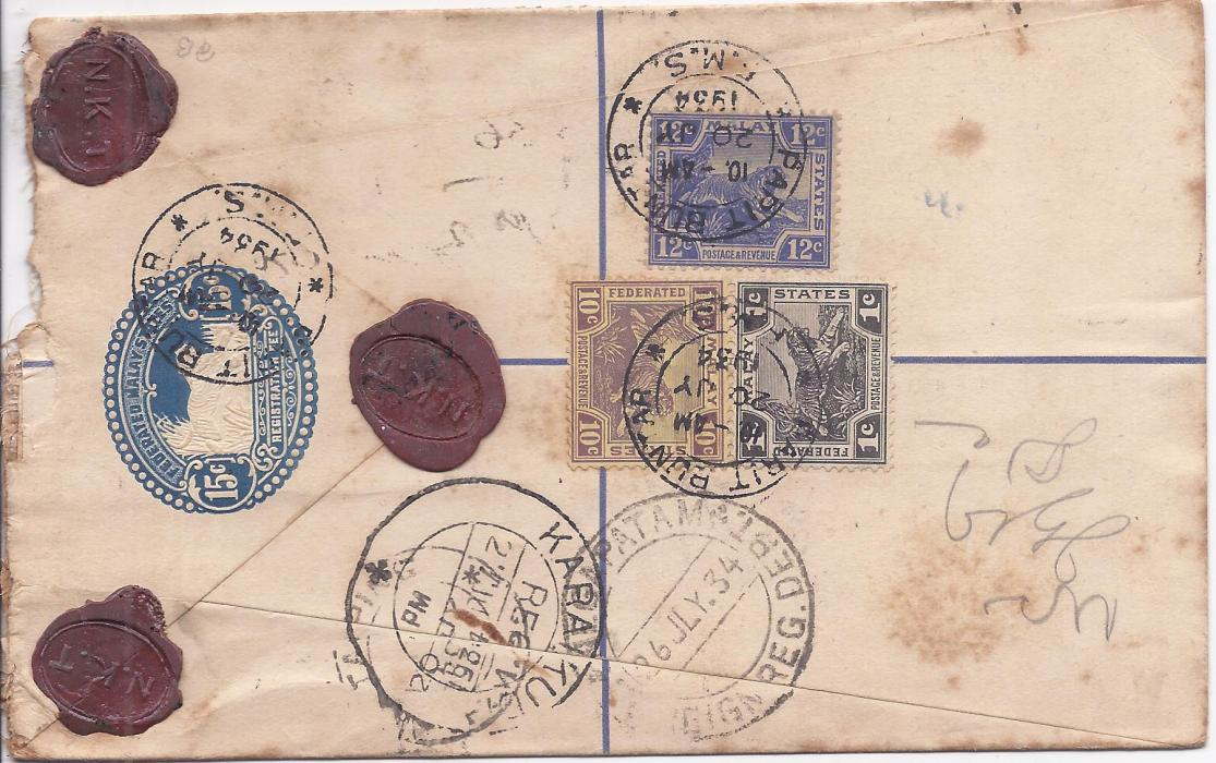 Malaya Perak: 1934 registered 15c. postal stationery envelope to India additionally franked 1c., 10c. and 12c. FMS tied Parit Buntar cds, front with registration handstamp with manuscript town name, Insured label with manuscript $65; some slight faults.