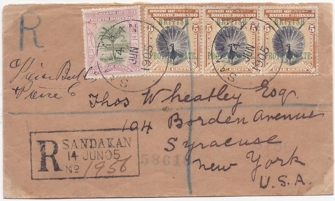 North Borneo 1905 registered cover from Sandakan to New York franked at 18c. rate by 1897-1902 3c. green and rosy mauve, perf 13� -14, and 1901-05 �BRITISH PROTECTORATE� 5c. black and orange-vermilion, strip of three, perf 14�-15, tied by two fine strikes of despatch cds, with very fine type R5 registration cachet at lower left. Backstamps of Singapore, London, New York and Syracuse. Some slight inconsequential toning.