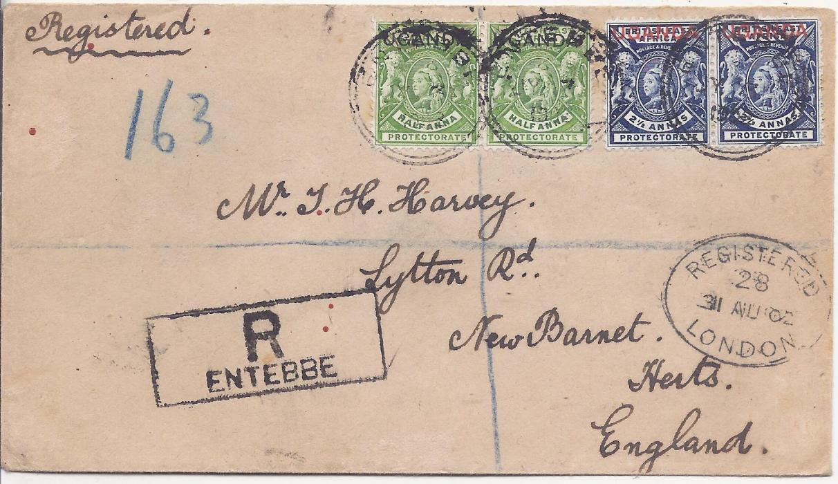 Uganda 1902 registered  cover to New Barnet franked 'UGANDA' overprinted ½ a. and 2½ a. pairs tied Entebbe cds, clear registration handstamp, London transit, reverse with Mombasa transit and arrival cds; good condition.