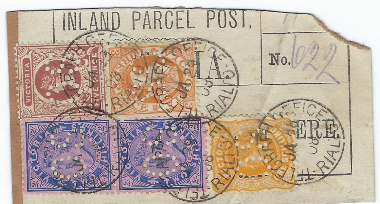 Australia Victoria: 1908 (JA 29) �Inland Parcel Post� label franked with a pair of watermark V over crown  2/- blue/rose plus a 1/- orange, 5d. brown and 3d. yellow-brown, all perforated OS, making a total of 5s8d postage, tied Telegraph Office Rialto cds.