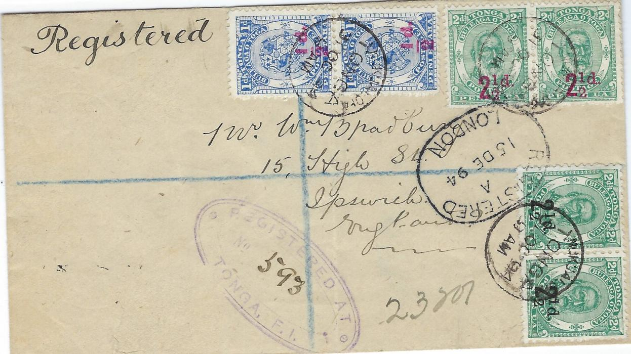 Tonga 1894 registered cover to England franked vertical pair 1/2d. on 1d. and two pairs of 2 1/2d. on 2d. in red and in black tied by neat cds, violet oval registration at centre, London Registration transit, reverse with Registered Auckland transit and Ipswich arrival cancels. The 11d. rate paying 6d. registration and 5d for double weight postage. Light vertical crease otherwise fine condition.