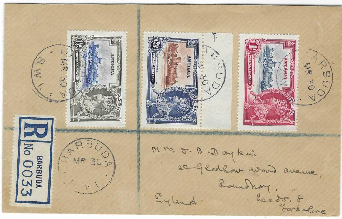 Antigua (Barbuda) 1936 registered cover to England franked by three 1935 Silver Jubilee values tied  Barbuda B.V.I. cds of MR 30 without year, reverse with St Johns transit. Registration label bottom left, the earliest recorded date for this, good condition.