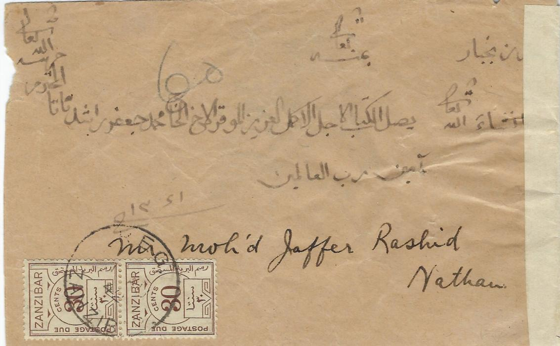 "Zanzibar (Postage Due) 1942 (1 AU) incoming censored stampless cover written in arabic and translated on arrival, maybe carried by private ship, charged ""60"" in pencil which would equate double deficiency of 3a6p (x2) the rate from the Gulf, and paid by 1936 Due 30c. brown vertical pair tied cds. Censorship on arrival with Opened by Examiner/  U tape. Ex Griffith-Jones."