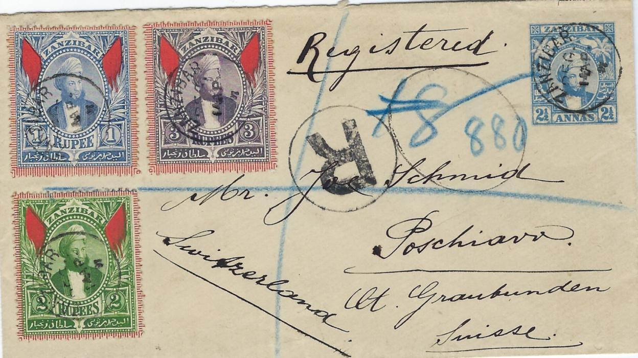 Zanzibar 1896 2 ½a stationery envelope registered to Poshciavo, Switzerland and additionally franked 1r. blue, 2r. green and 3r. dull purple each cancelled by thimble cds, reverse with Aden transit and arrival cds. The front also shows blue manuscript registration of Indian Sea Post Office; fine and attractive.