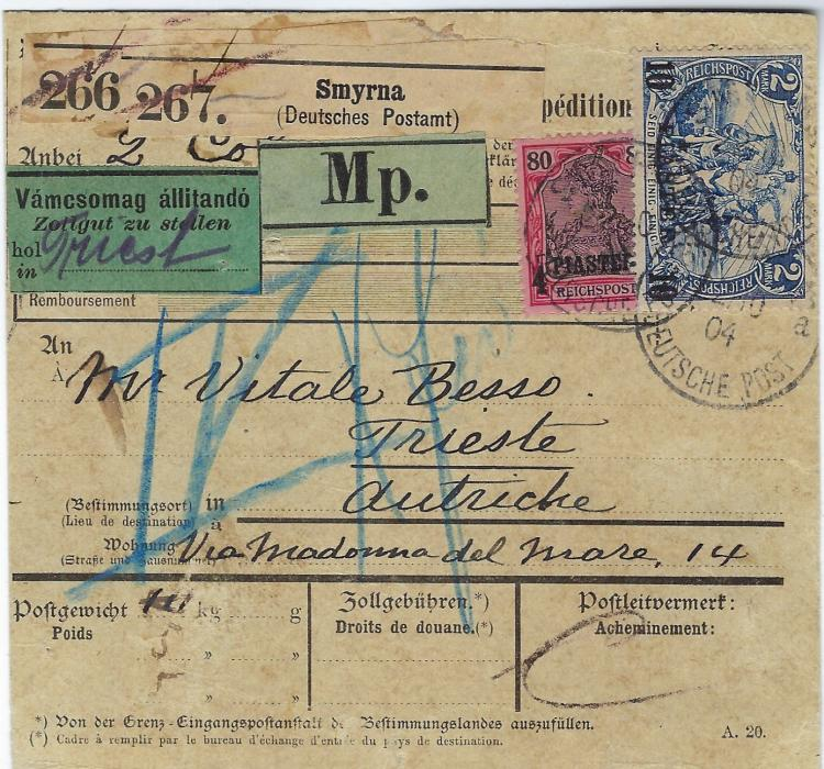 Germany (Post Office in Turkish Empire) 1904 (22 Oct) parcel card to Trieste, Austria franked 1900-04 Reichpost 4 Piaster on 80pf. and 10 Piaster on 2mk tied Smyrna Deutsche Post cds, reverse with transits of  Constantinopel (24/10) Constanta 26/Oct and Orsova 28/Oct plue arrival cancel of 31.10. A couple of slight faults.