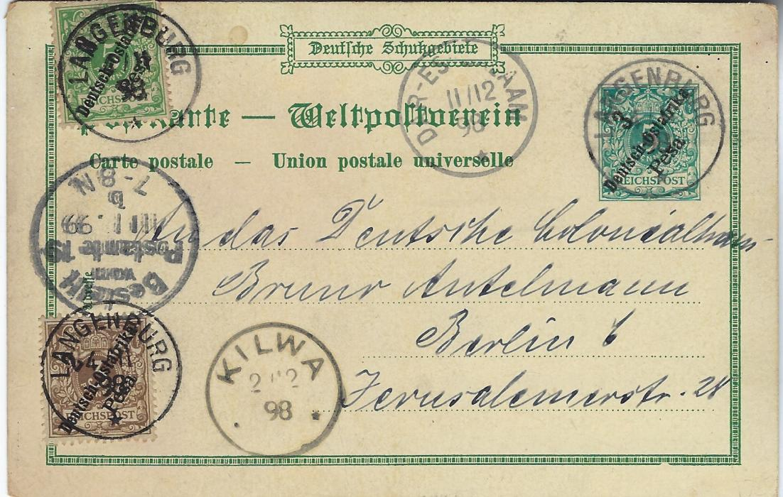 German Colonies (East Africa) 1898 3 Pesa on 5pf 'Gruss aus Kilwa' picture stationery card used to Berlin and uprated with 2 Pesa on 3pf. and 3 Pesa on 5pf. tied Langenburg cds of 4/11 98, Kilwa transit 2/12 and Dar-es-Salaam transit 11/12, arrival cancel at left of 11/1/99. The 3Pesa on 5pf stamp slightly proud of card with slight damage and some edge wear to front of card.