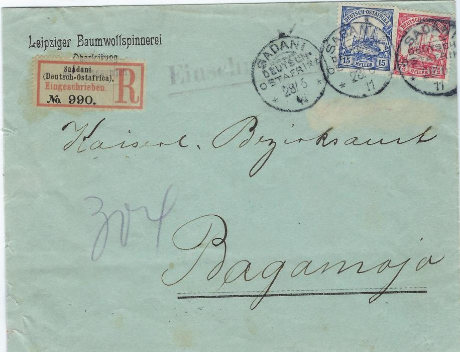 German Colonies (East Africa) 1911 registered internal cover to Bagomojo franked 7 1/2h. and 15h. tied Sadani DOA cds, registration label at left with manuscript corrected name, arrival backstamp. Some reinforcements to envelope at rear.