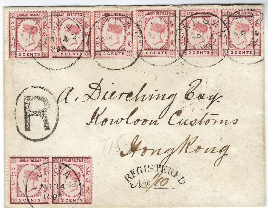 Labuan 1895 (MR 14) registered cover addressed to Kowloon Customs/ Hong Kong franked at double rate (12c postage 4c registration) with 1892-93 2c rose-lake in two strips of three and one pair tied by series of cds, oval framed R and cursive REGISTERED handstamp, reverse with Singapore transit of MR 19 and Hong Kong cds of MR 25
