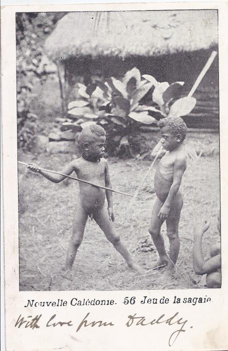 New Caledonia c.1900 card of two native children, stamps on reverse partly removed