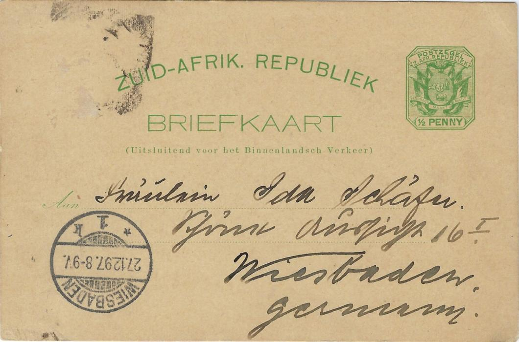 Transvaal (Picture Postal Stationery) 1897 (27.12.) ½ Penny green card with additional ½d. removed at left entitled  'Greetings from Johannesburg' with four small images Telephone Tower, Morning Market, Harry Graumann member of the Sanitary Board and Commissioner Street, used to Wiesbaden, Germany.
