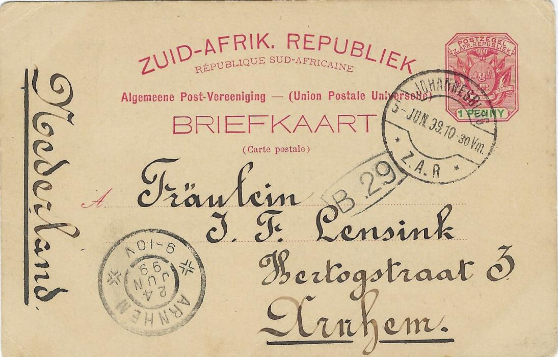 Transvaal (Picture Postal Stationery) 1899 (24 Jun)  1 Penny carmine and green card entitled Greetings from Pretoria  with image of The Standard Bank, used to Arnhem, Nederland; small stain bottom right.