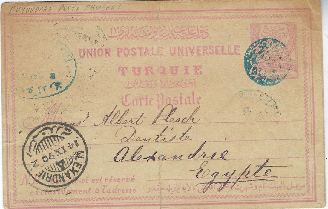 Turkey 1890 20 paras postal stationery card with heavy reinforced central crease to Alexandria cancelled by fair strike of the rare blue negative seal of Buyukdere Posta Subesi (ASP type 5, rated RRR), oval date stamp in association at left, Constantinople transit and arrival cds. Some faults but a rare item.