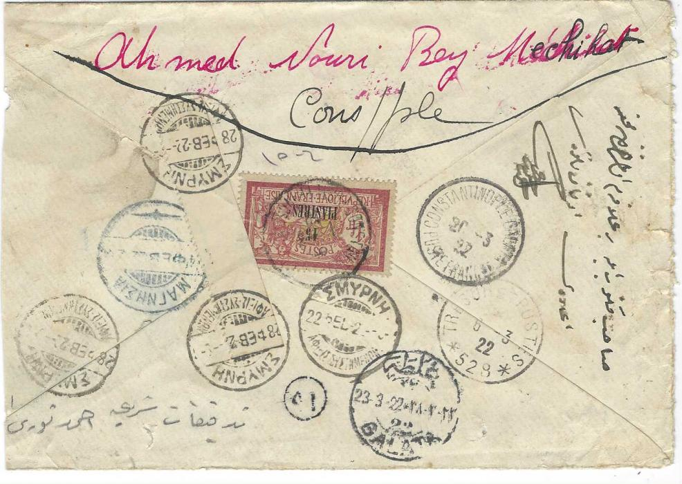 "French Levant 1922 (1.3.) registered cover from Constantinople to Magnissa, Greece bearing on reverse single franking Merson 15pi. on 1f. tied French Post Office cds, transit Tresor et Postes 528 (of Smyrna), Greek Smyrna transit of 22 Feb and blue arrival cds of 24th where bilingually inscribed ""Retour"", Greek Smyrna cds of 28th and a strip of selvedge applied and tied by two further strikes, return cancels of Constantinople and Galata; slightly reduced at side."