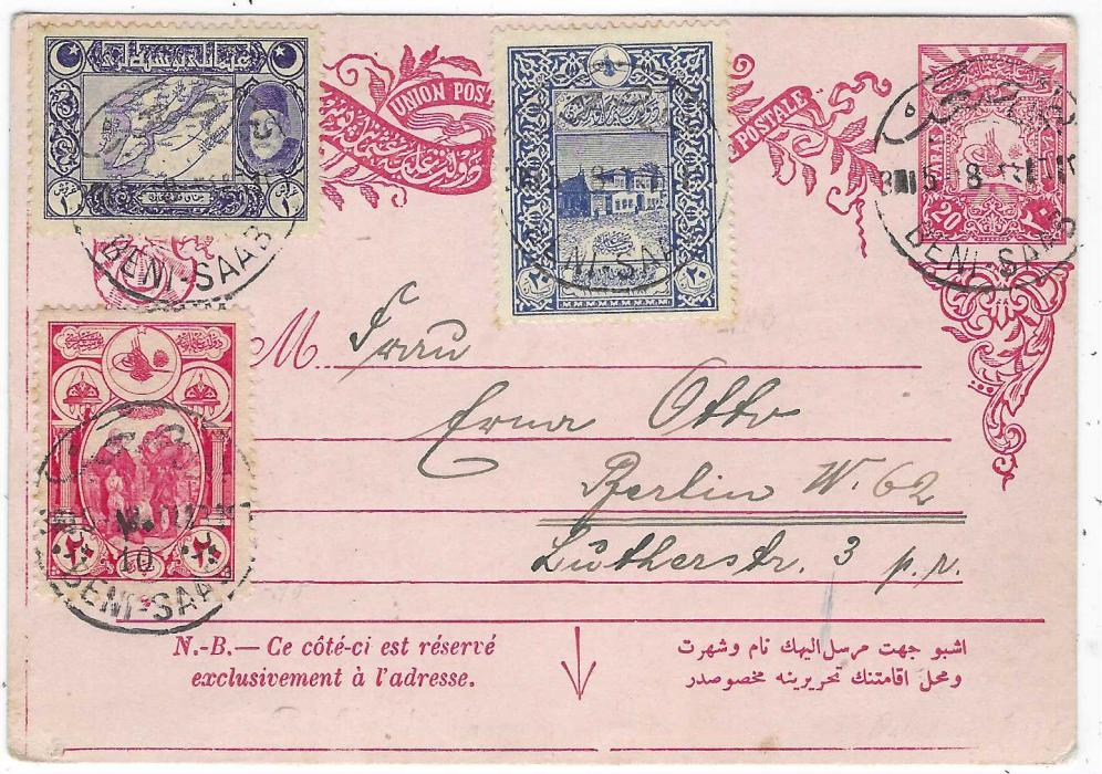"Palestine (Ottoman) 1918 20pa postal stationery card to Berlin additionally franked with three commemorative values tied Beni-Saab bilingual cds, the card with message is date-lined ""Tul Karm""."