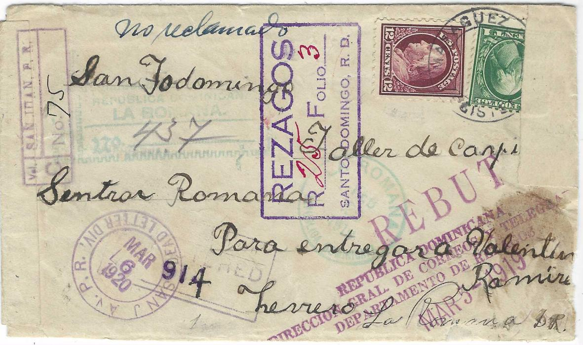 """Puerto Rico (Puerto Rico) 1918 registered envelope to La Romana, Dominican Republic, franked U.S. 1c. and 12c. tied by unclear black Mayaguez date stamp, reverse with two violet cds of Set 27 one that has been overlaid by censor tape, maybe kept by censor as next backstamp is from La Romana date Oct 2 1918, front with blue m/s """"no reclamado"""", various registration handstamps and final return Mayauezcds of Abr 15 1920. A repair was made to the envelope at La Romana with the paper used tied by light blue-green handstamp, on return  violet three-line 'Received in bad condition at Dead Letter Office, San Juan, Porto Rico'."""
