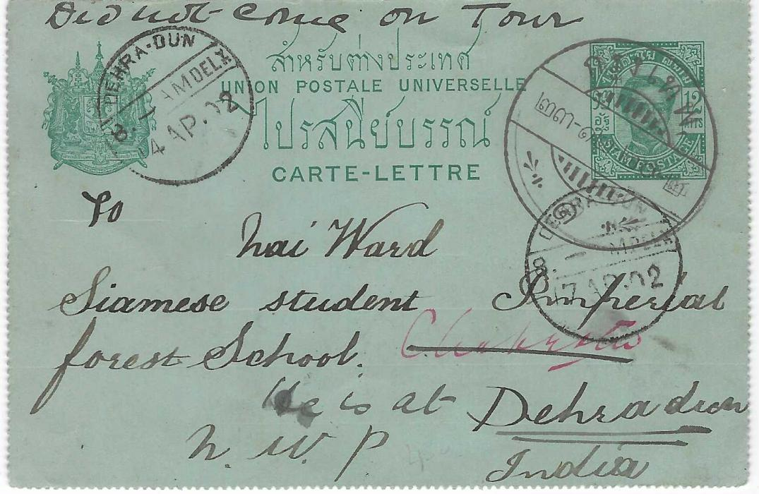 """Thailand 1902 King Chulalongkorn 12a.  postal stationery letter card to India addressed to a """"Siamese Student, Imperial forest School, N.W.P."""", various redirections with at top, manuscript """"did not come on Tour"""" and """"He is at Dehradun"""", Krung Thep despatch  with further strike on reverse, Singapore  transit and Indian cancels. Without selvedge and parallel lines of toning on reverse."""