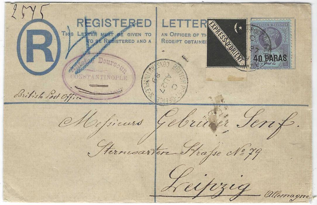British Levant (Express D'Orient) 1889 (AU 27) registered formula stationery envelope to Leipzig franked '40 PARAS' on 2½d. plus rare black label tied by single BRITISH POST OFFICE CONSTANTINOPLE index C cds, arrival backstamp and with selvedge of stamp used to additionally seal envelope; a fine example.