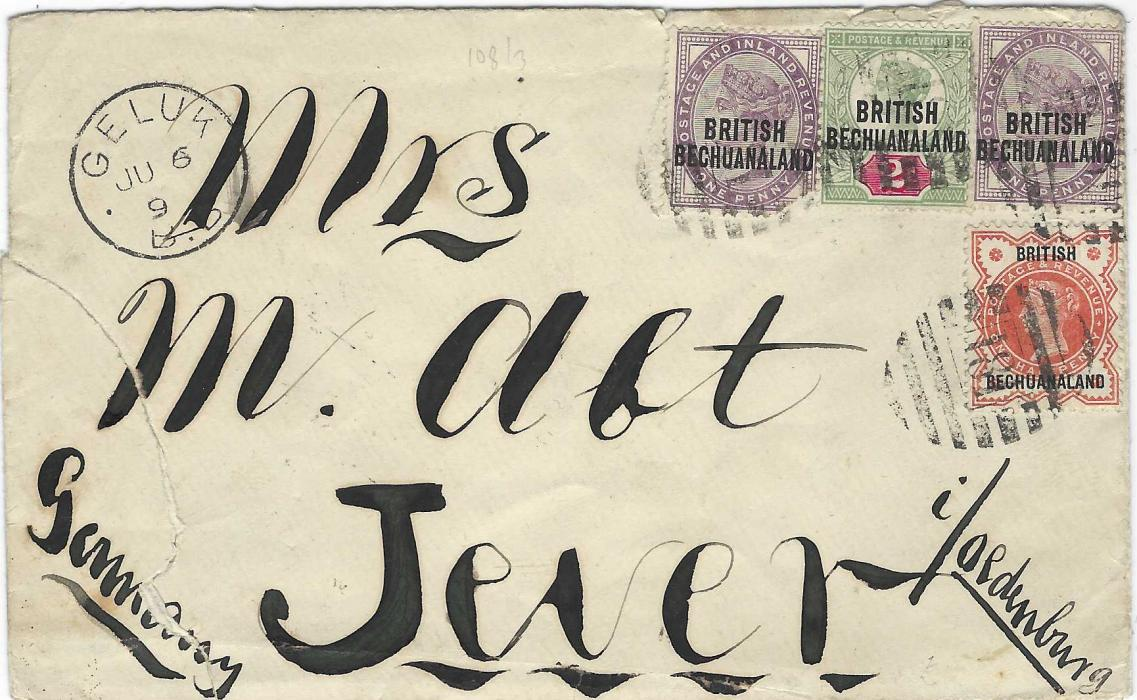 Bechuanaland 1895 (JU 6) envelope ornately addressed to Jever, Germany franked Great Britain overprinted 1888 ½d. vermilion and 1891-1904 1d. (2, one missing bottom right corner) and 2d. cancelled '181' obliterators with Geluk B.B. cds at left, transit and arrival backstamps; envelope torn and repaired on reverse.