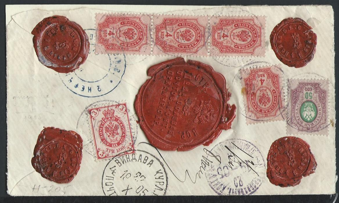 RUSSIA � Russo Japanese War:  Insured cover used to send 300 roubles to Vindava, franked on reverse 3k, 4k (strip of 3 & single) & 50k Arms issue, cancelled in violet �NO 4 FIELD POST OFFICE / PRIAMUR DISTRICT 18 IX 1905�. Wax seals with same inscription. Blue cachet of 2nd NERCHINSK COSSACK REGIMENT. Blue-lined registration label reads �RESERVE FIELD POST OFFICE No 4� with NINGUTA added by hand. Received VINDAVA, Courland Province (Baltic States) 22 X 1905. This cover established the location of No4 FPO at Ninguta, Manchuria. Illustrated K.Adler �British Journal of Russian Philately� 16 (1954), page 471. Ex Dr. Casey