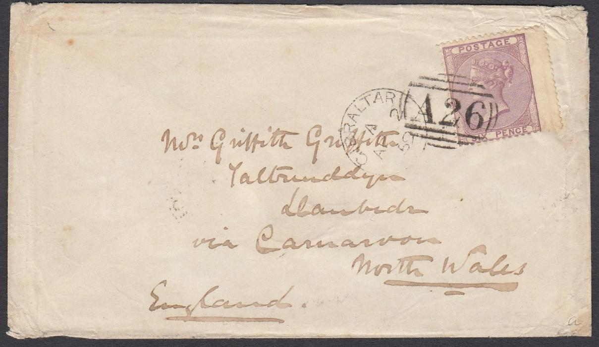 GIBRALTAR 1859 cover to Llanbadn, Wales, franked GB 5d wing marginal tied by barred oval A26 with Gibraltar cds in association, Carnarvon transit backstamp. The cover with peripheral wear but the stamp very fine with an exceptional strike. An attractive early example of the A26 obliterator (introduced 20 Feb 1859).