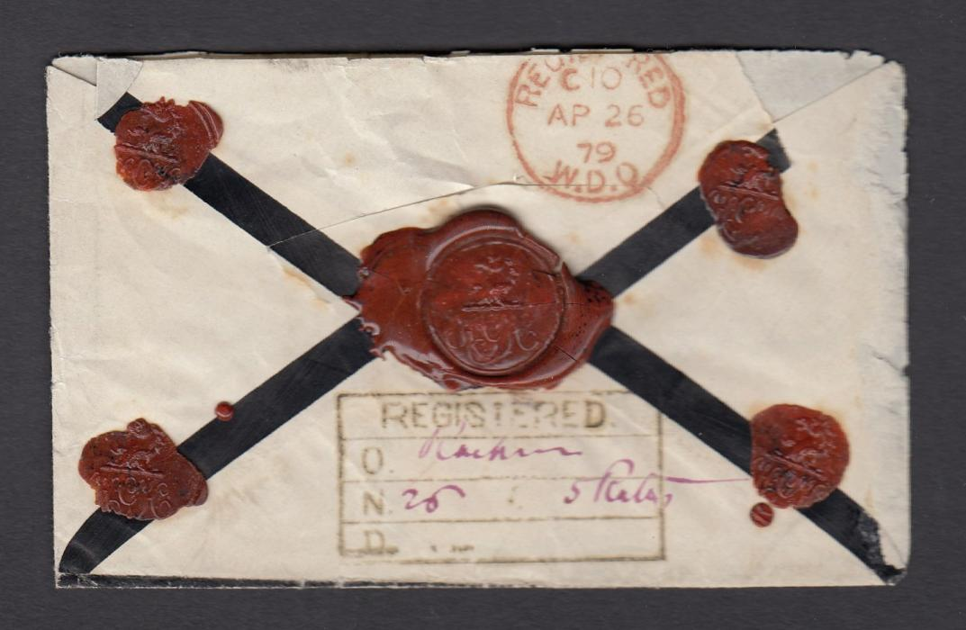 INDIA 1879 mourning envelope to London franked 2a and pair 4a tied N-7 numeral duplexes, registration handstamp on reverse with manuscript details, arrival on front; some slight faults to envelope otherwise an attractive item.